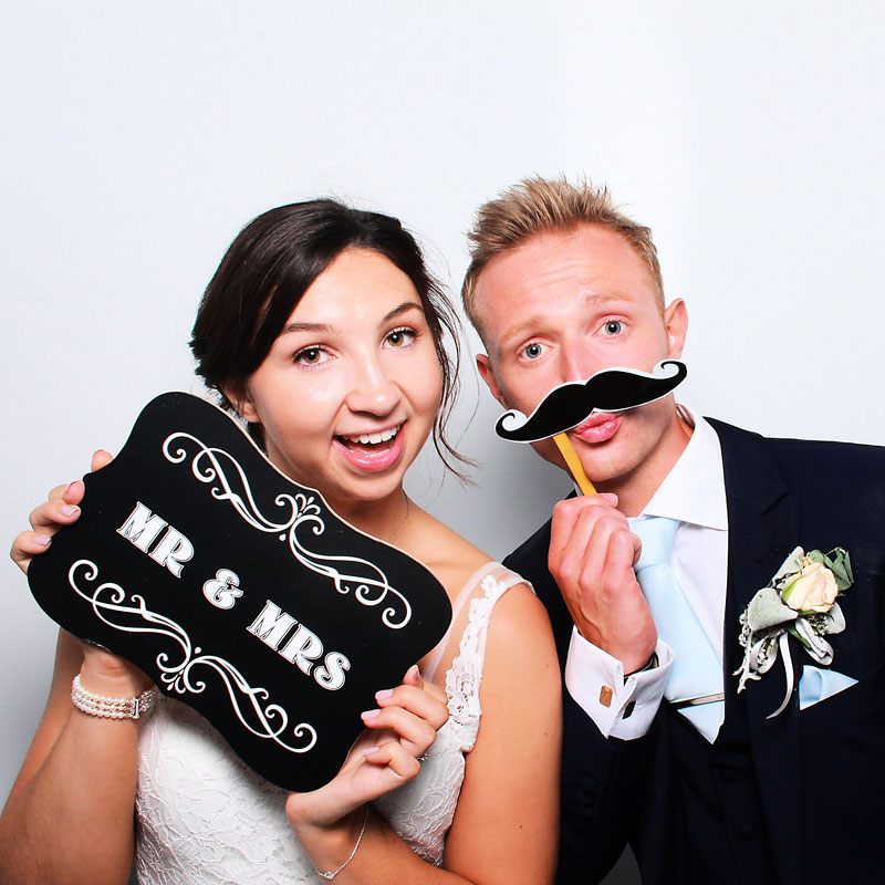 Mr and Mrs in the wedding photo booth