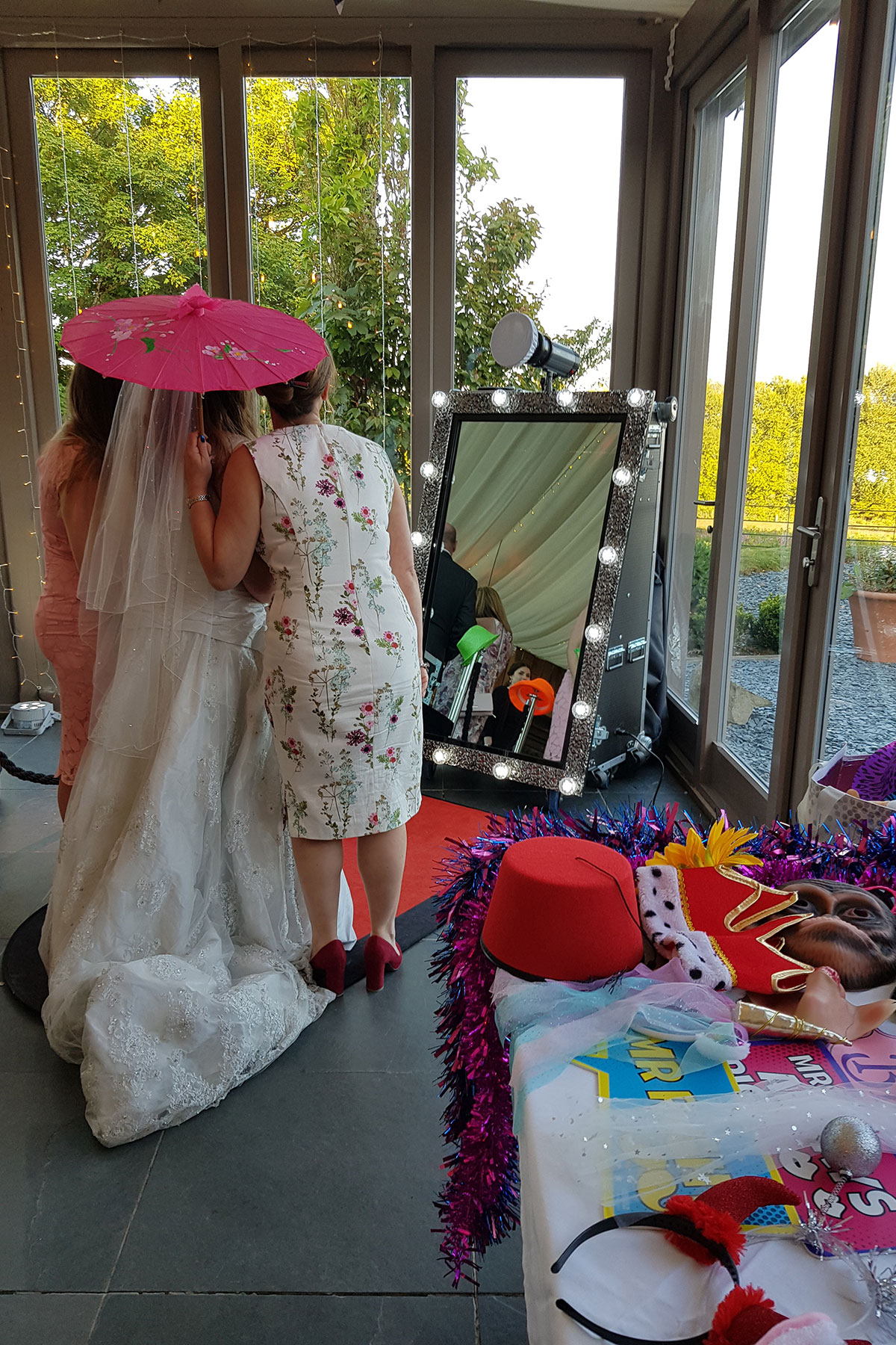 See bride using the magic mirror booth at her wedding